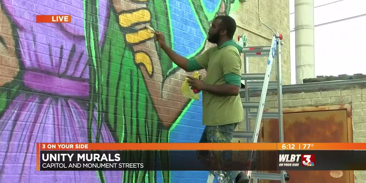 Artists create murals to beautify and unite downtown's inner city