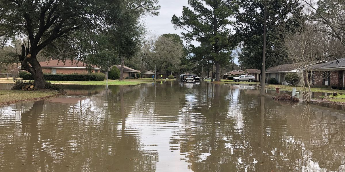 Open Spillway gates send water downstream into Jackson homes and businesses