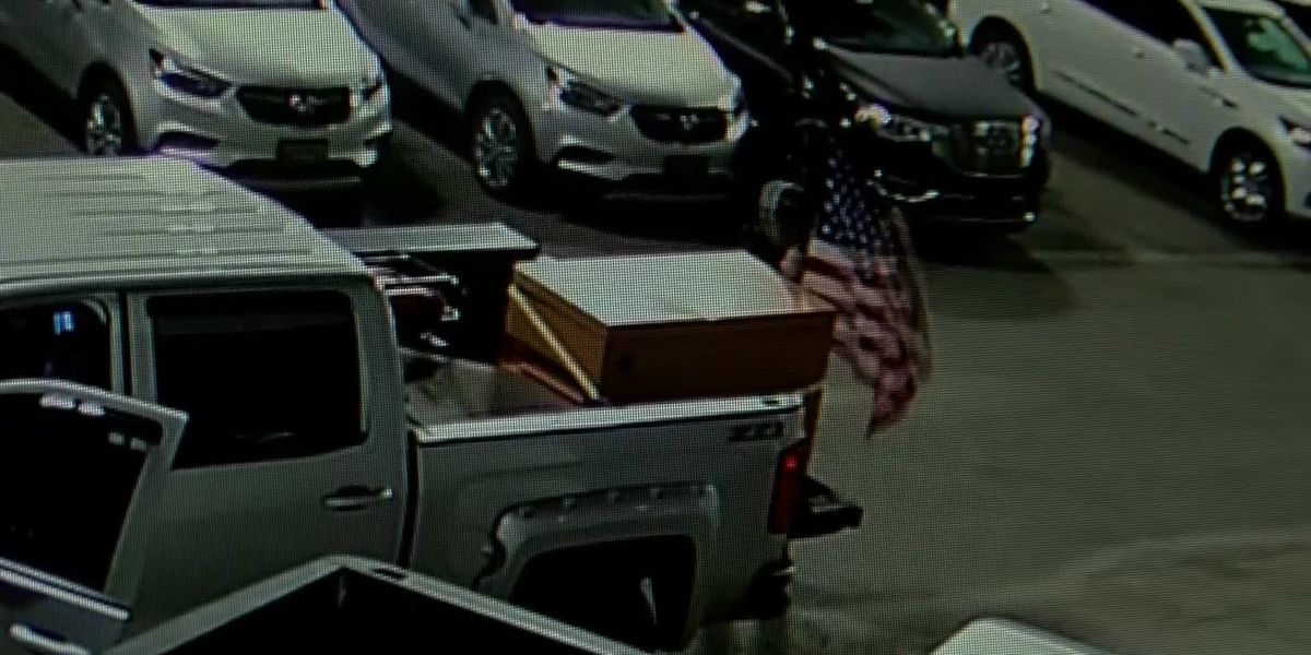 Patriotic burglar breaks into trucks before falling asleep inside parked car at dealership