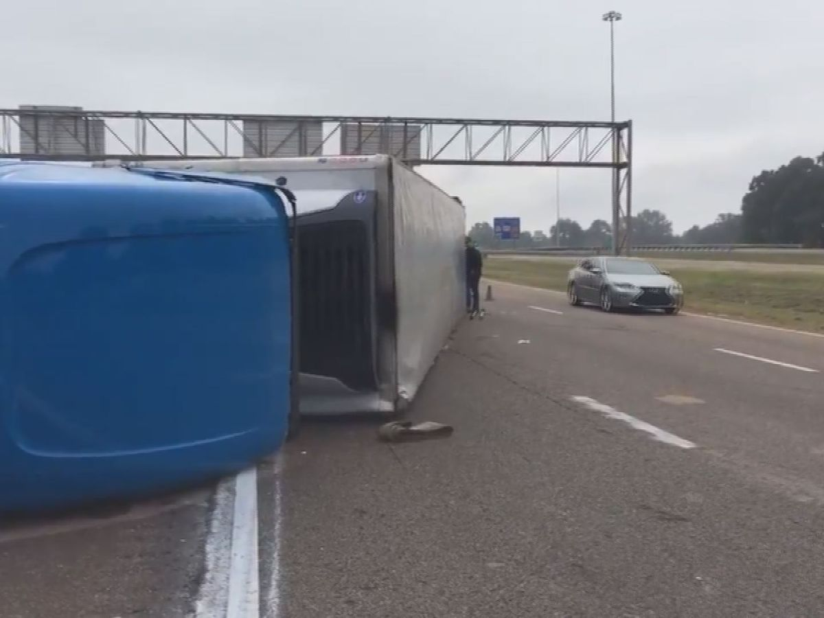 18-wheeler carrying frozen seafood overturns on Terry Road in Jackson