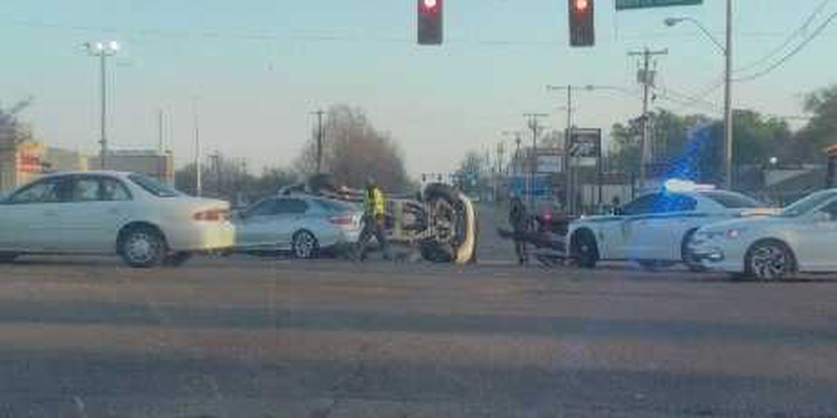 Car flipped at intersection of Woodrow Wilson and Bailey Ave.