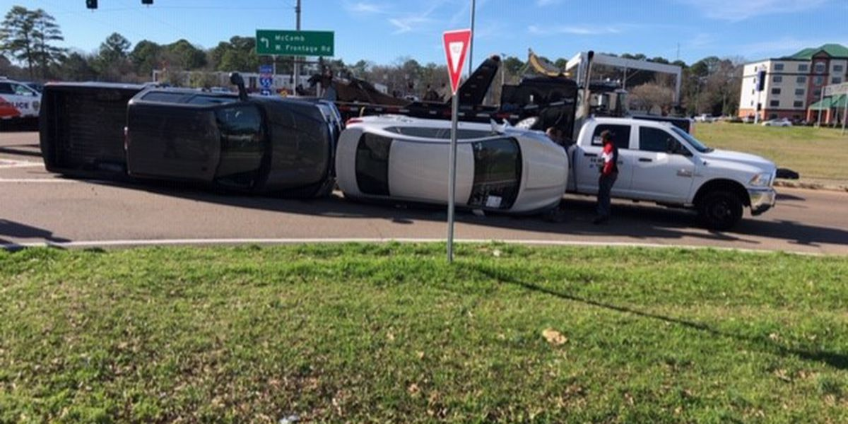 Truck carrying cars overturns on I-55 exit ramp