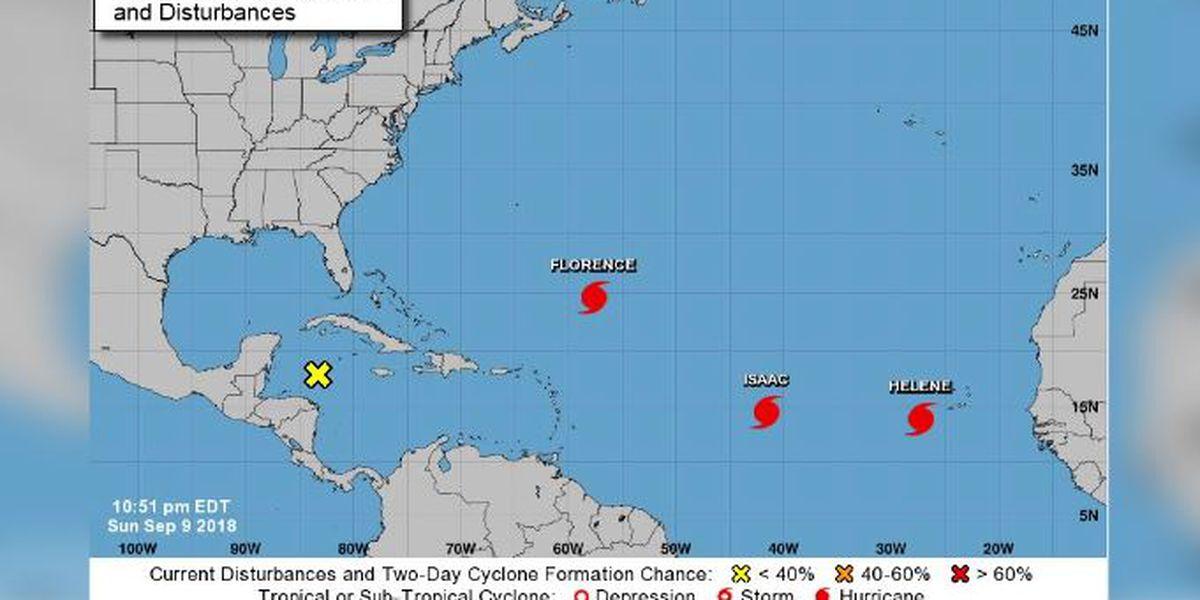 Isaac becomes 3rd hurricane sweeping through Atlantic