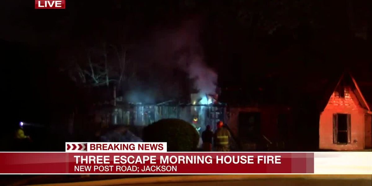 Three people escape morning house fire, investigation underway