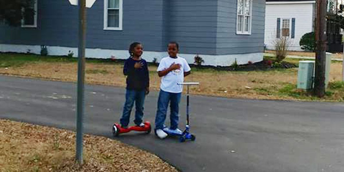 Picture of North Carolina boys stopping to honor US flag goes viral