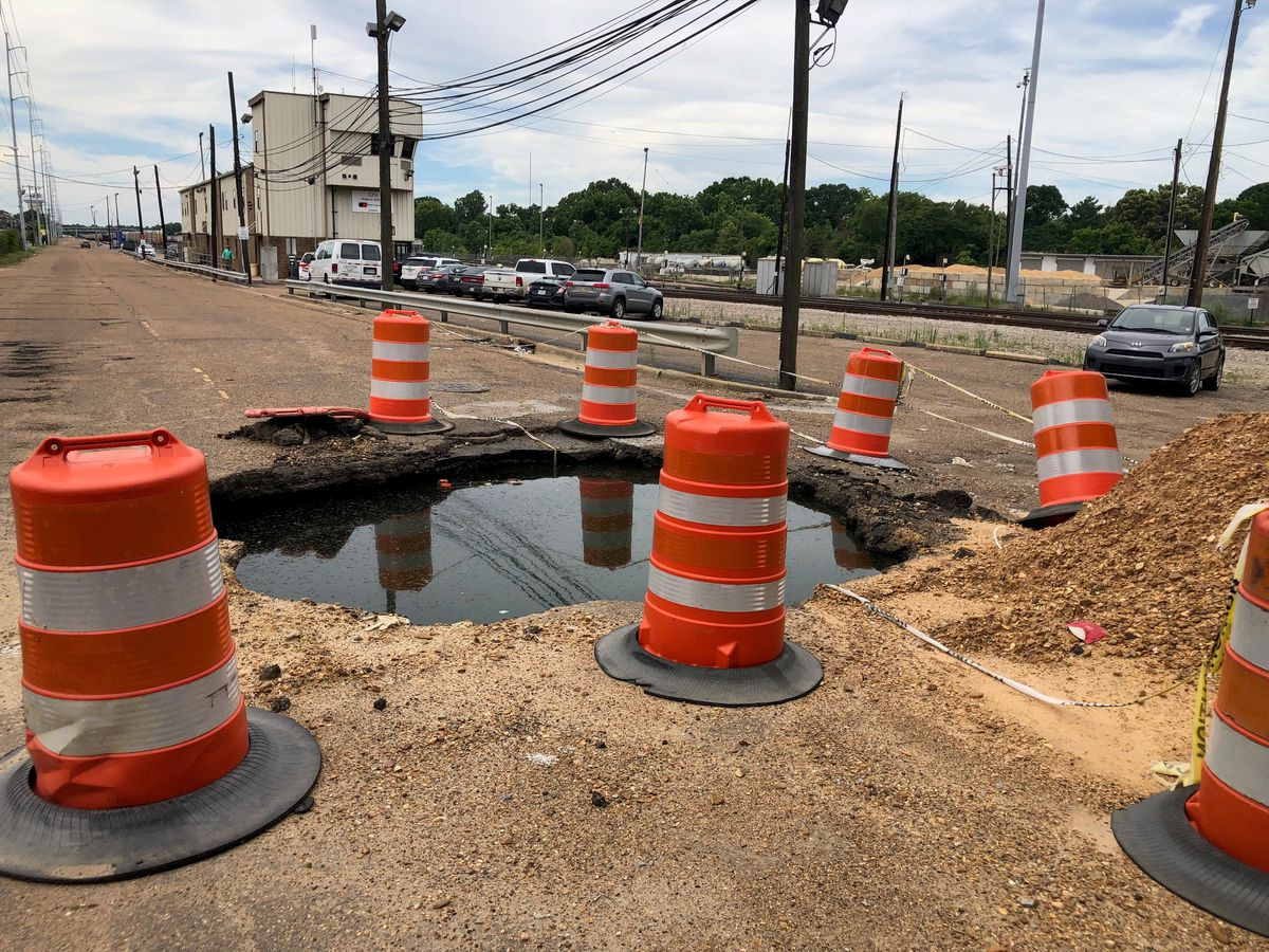 """Giant sinkhole on Mill Street nicknamed """"The Swimming Pool"""" by local workers"""