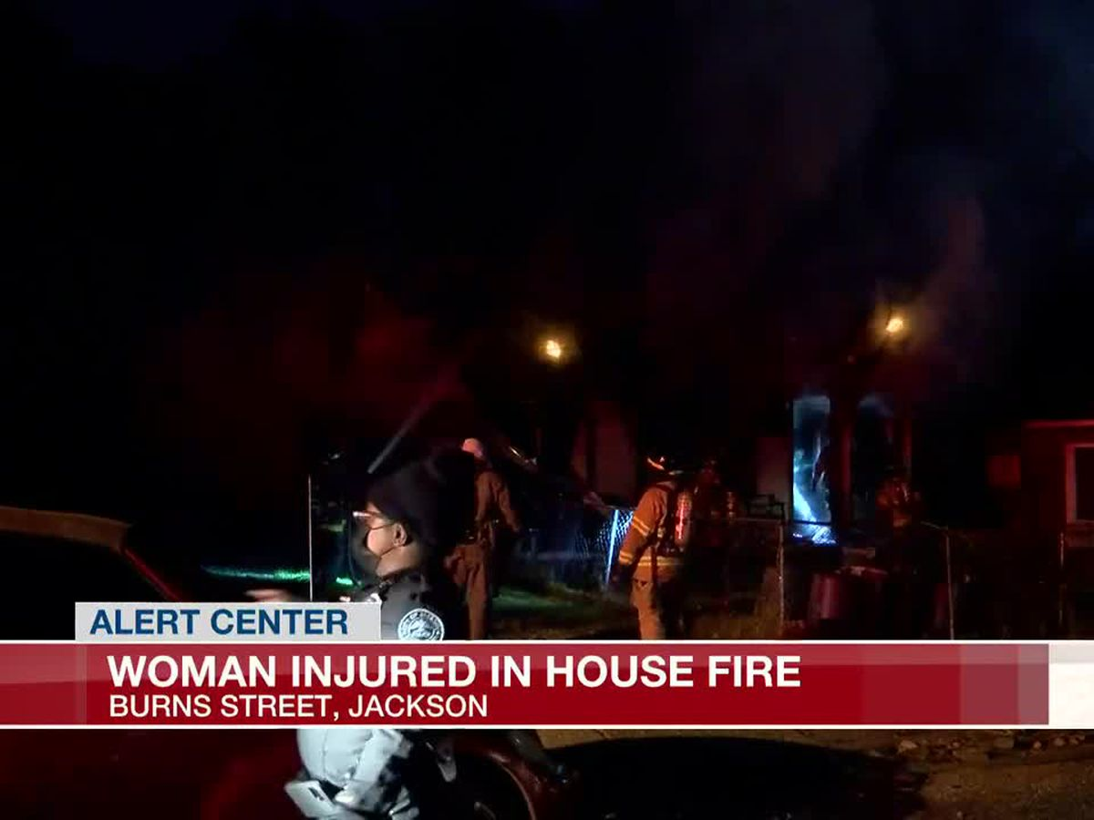 Seven people escape Jackson house fire, one woman injured