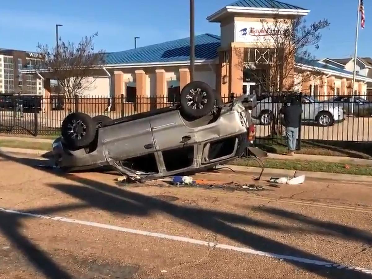 VIDEO: SUV overturns after crash involving JPD officer