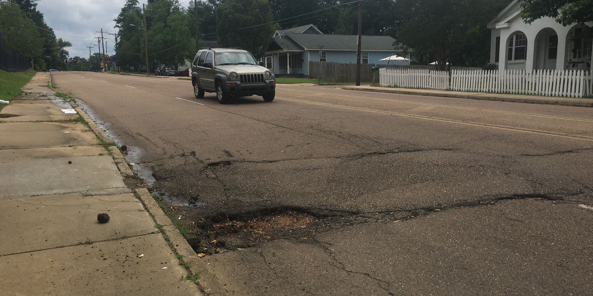 Pothole claims another tire, driver says unmarked spot is a safety hazard