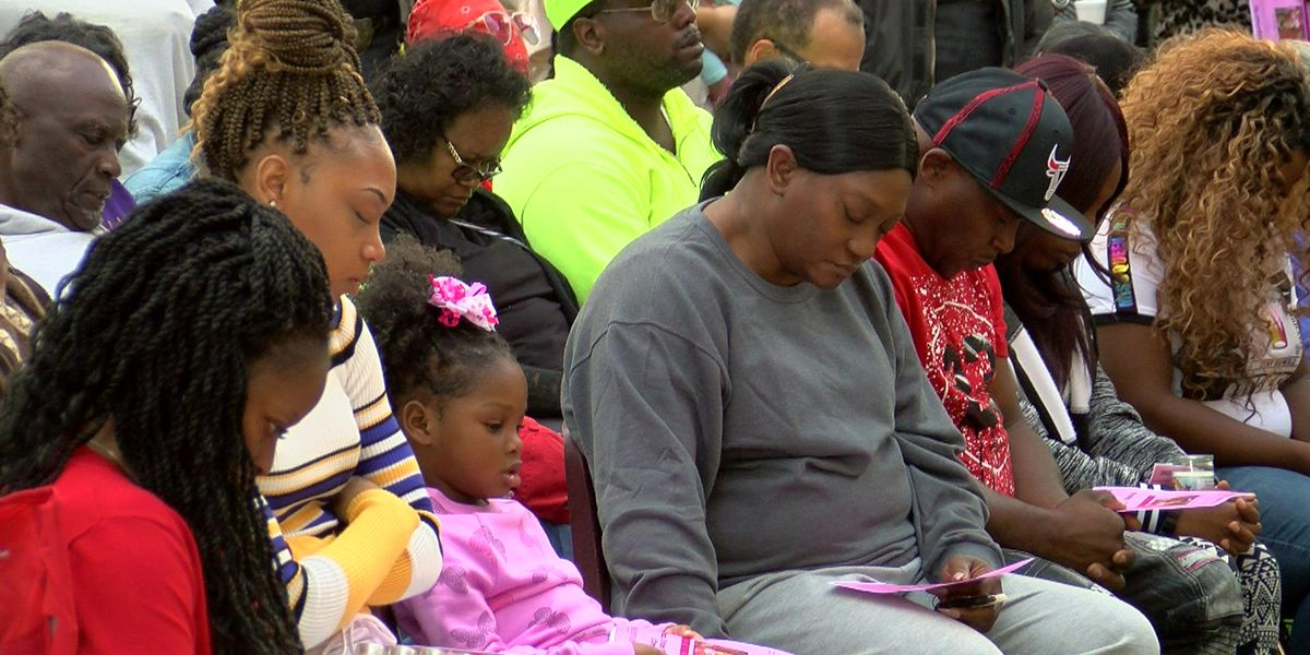 'We always look out for each other': Community comes together at candlelight vigil for toddler stabbed, cooked in oven