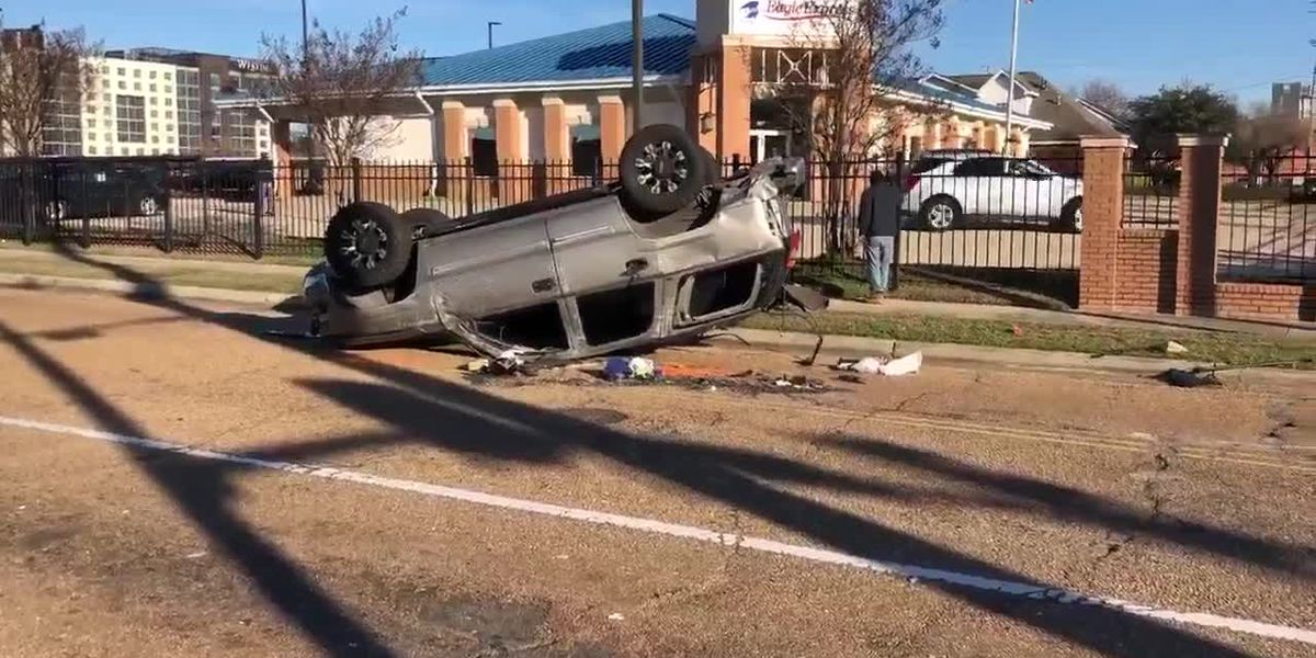 VIDEO: SUV overturns after crash with JPD officer