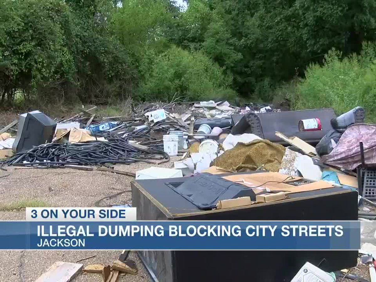Illegal dumping practically blocks neighborhood intersection