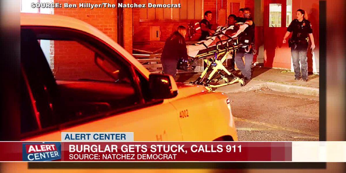 Natchez burglar calls 911 for help after getting stuck