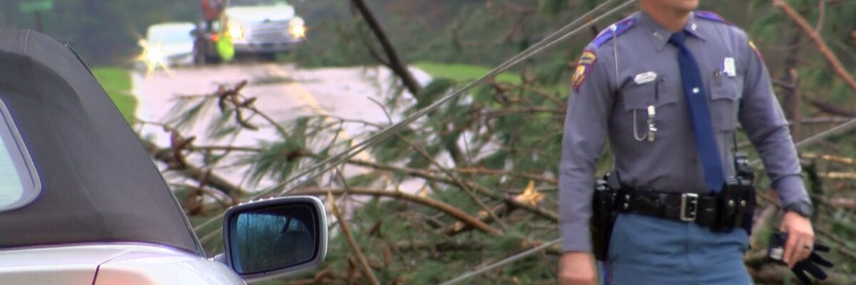 Apparent tornado damages homes, downs trees and power lines in Simpson County
