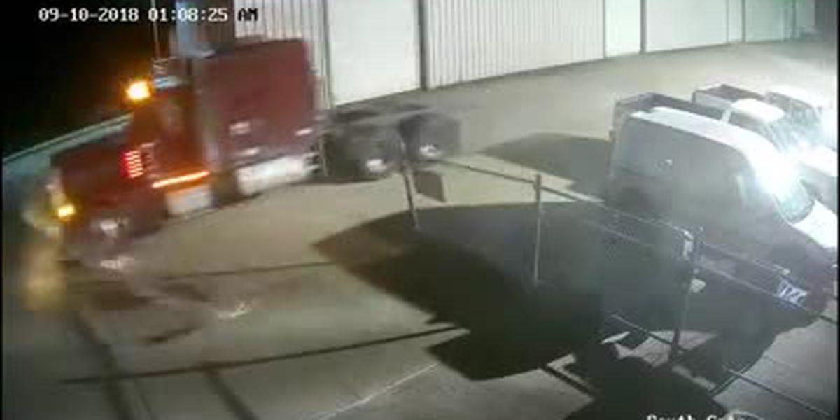 WATCH: Thief steals semi-trailer truck from dealership, crashes through gate