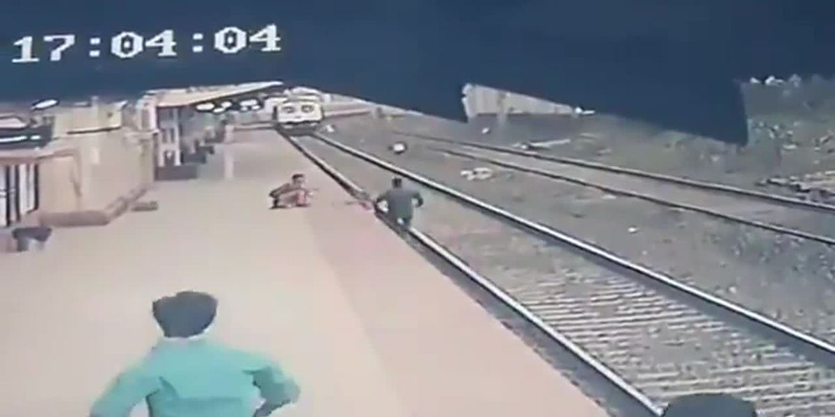 See moment child is saved from oncoming train