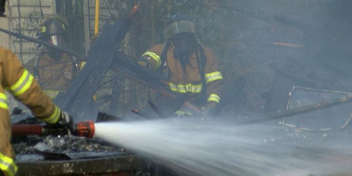 Jackson firefighters extinguish fully involved house fire that spread to neighboring home