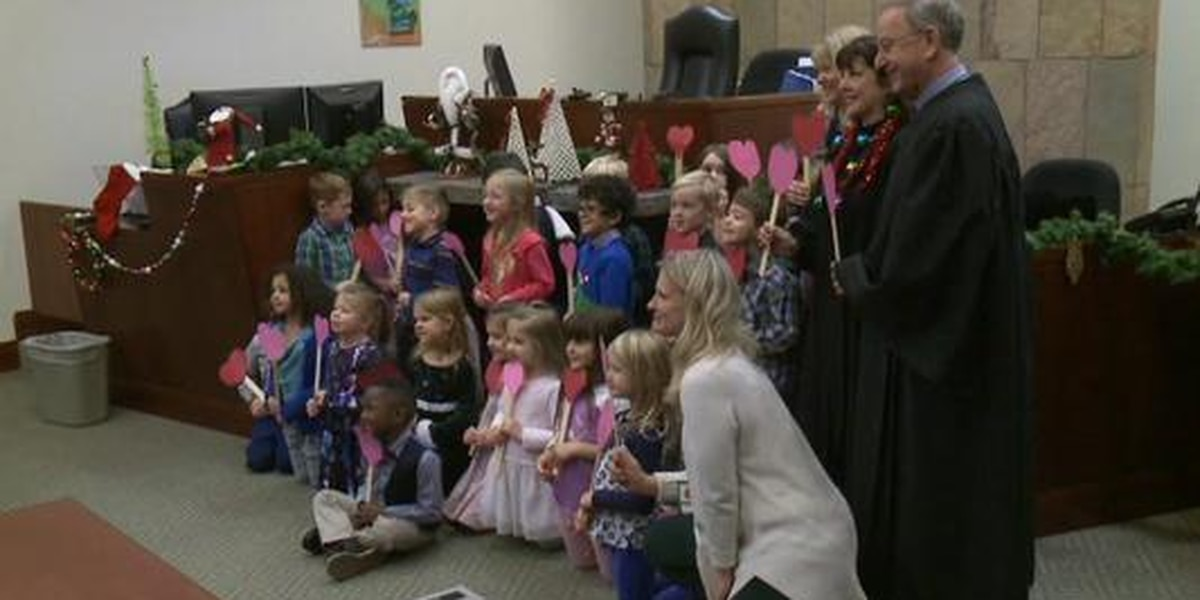 Boy brings classmates to adoption ceremony