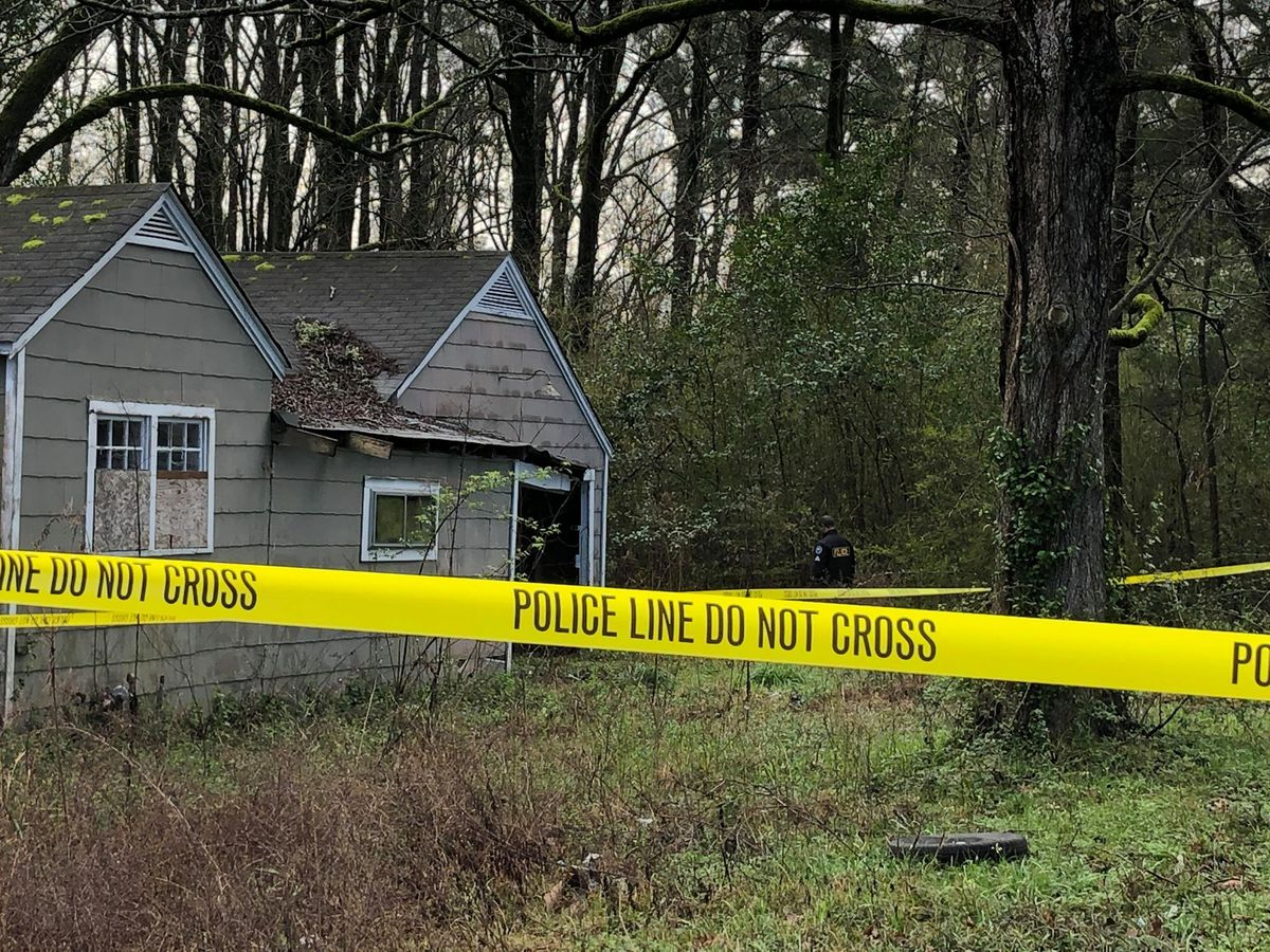 Homicide investigation underway after body found in trash can behind Jackson home