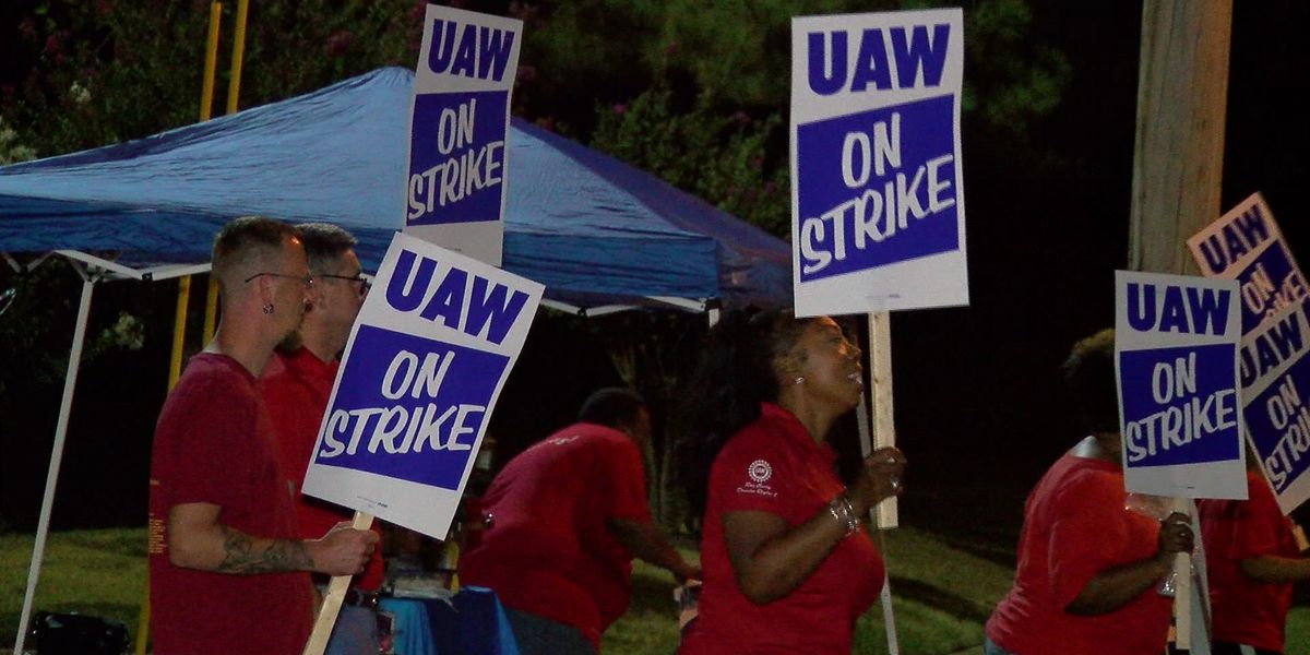 GM stops paying for health care for striking workers; union to cover costs as strike continues
