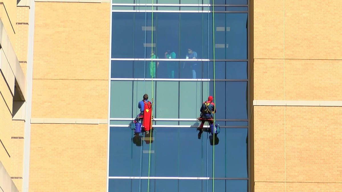 Window washers surprise kids at hospital with Superman, Spider-Man costumes