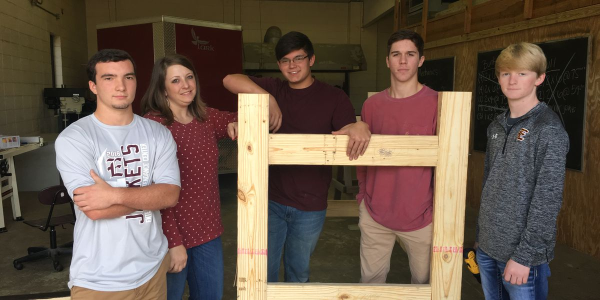 High school students build beds for less fortunate