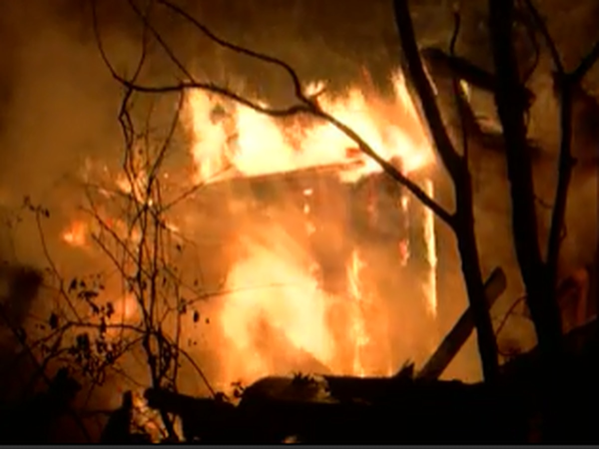 Husband and wife escape house fire in Raymond