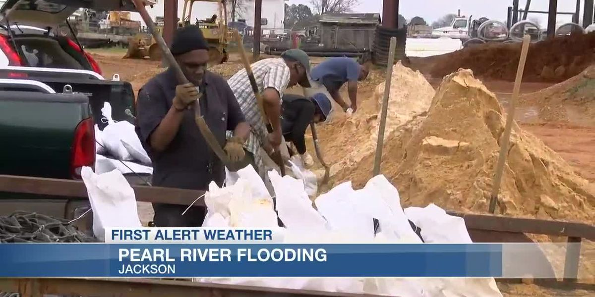 Residents filling sandbags in preparation of Pearl River flood