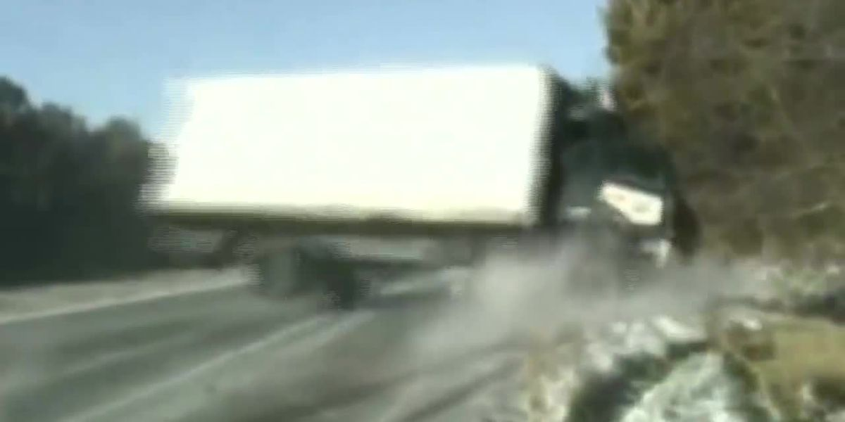 Trooper saves woman from sliding truck