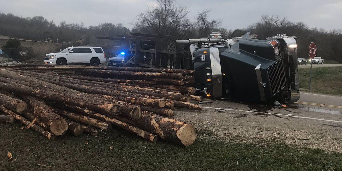 Log truck overturns in Warren County; driver taken to hospital