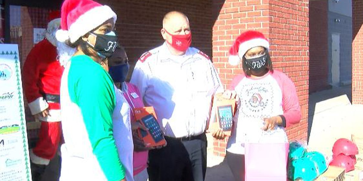 Local organization adopts four families and the Salvation Army for Christmas
