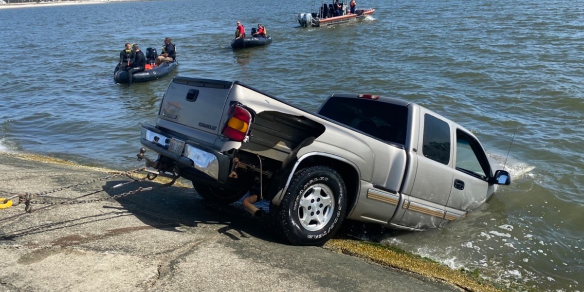 Truck pulled out of water in Gulfport, dive teams searching the area