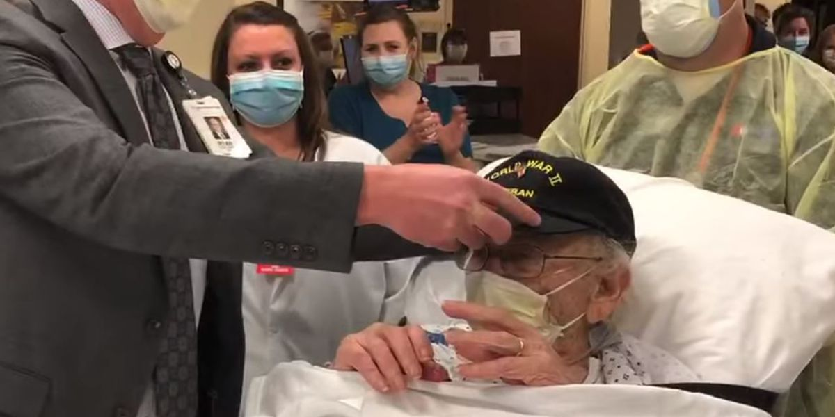 100-year-old WWII veteran gets standing ovation at hospital after beating COVID-19
