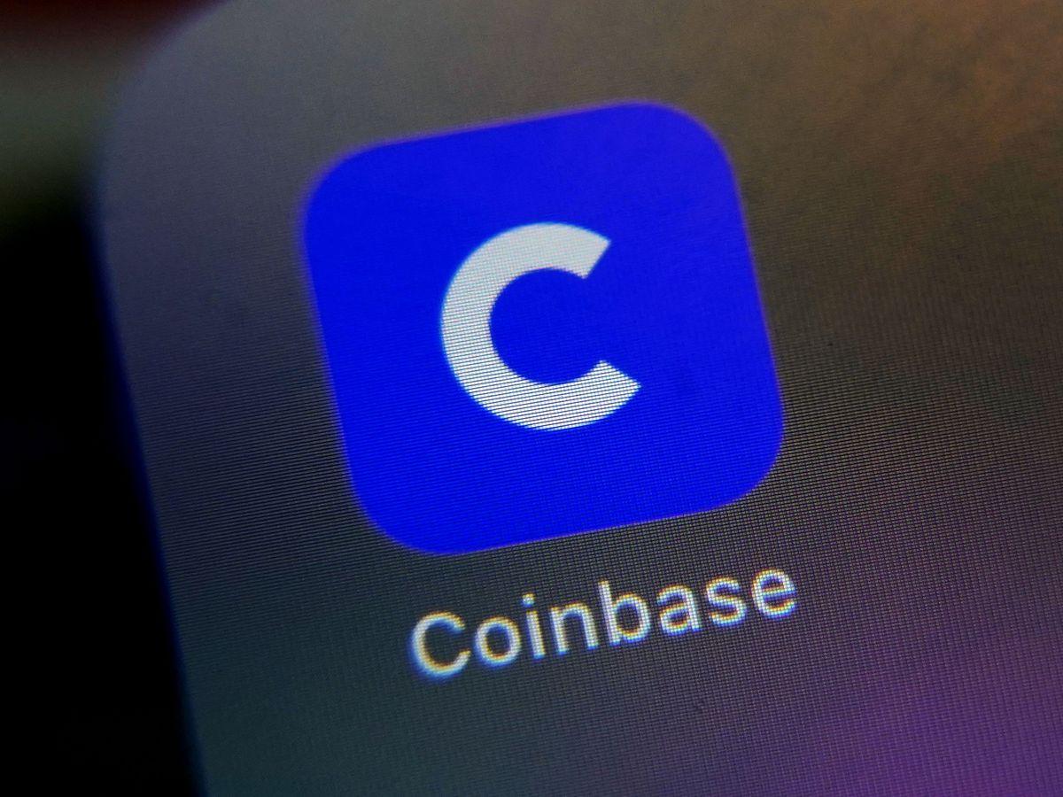 Coinbase soars in market debut, valued near $100 billion