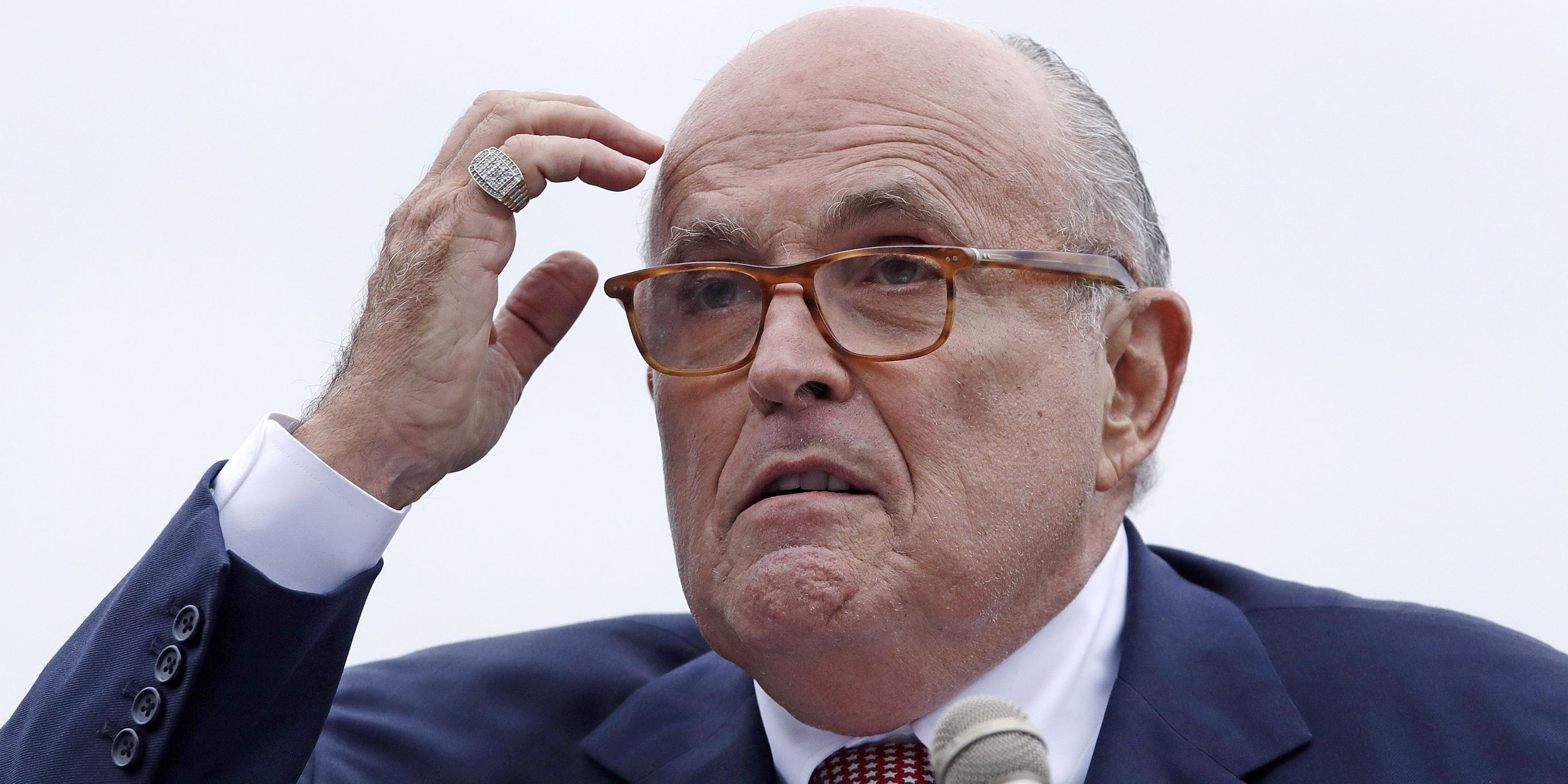Giuliani's tweet links to a 'Trump is a traitor' website. He blamed Twitter, but his typo is responsible.