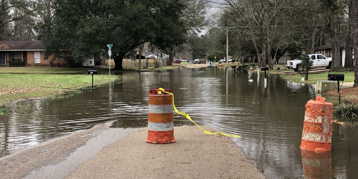 Neighbors on edge as flood waters rise in Jackson streets