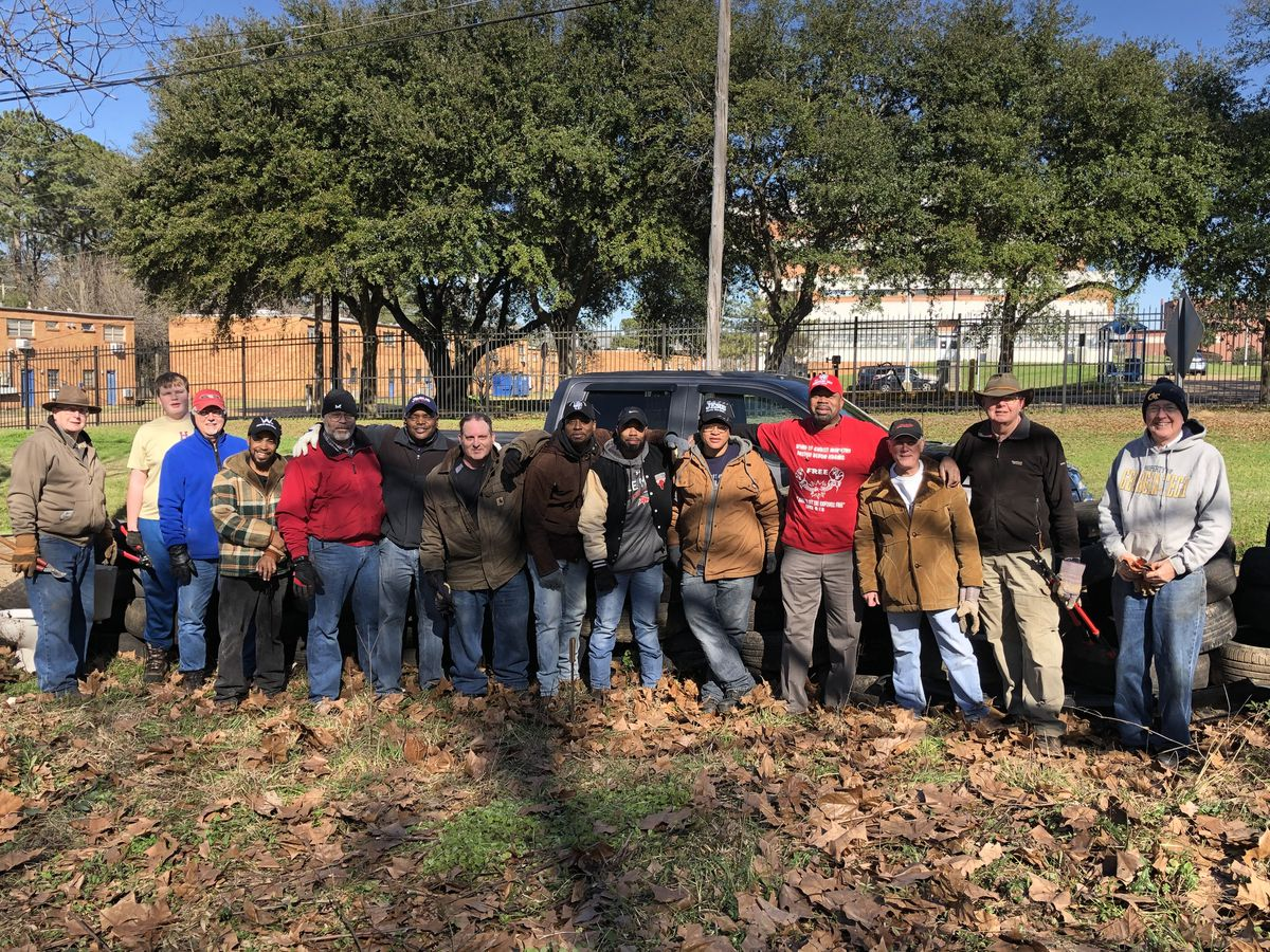 Jackson churches clean illegal tire dumping site on MLK Day of Service