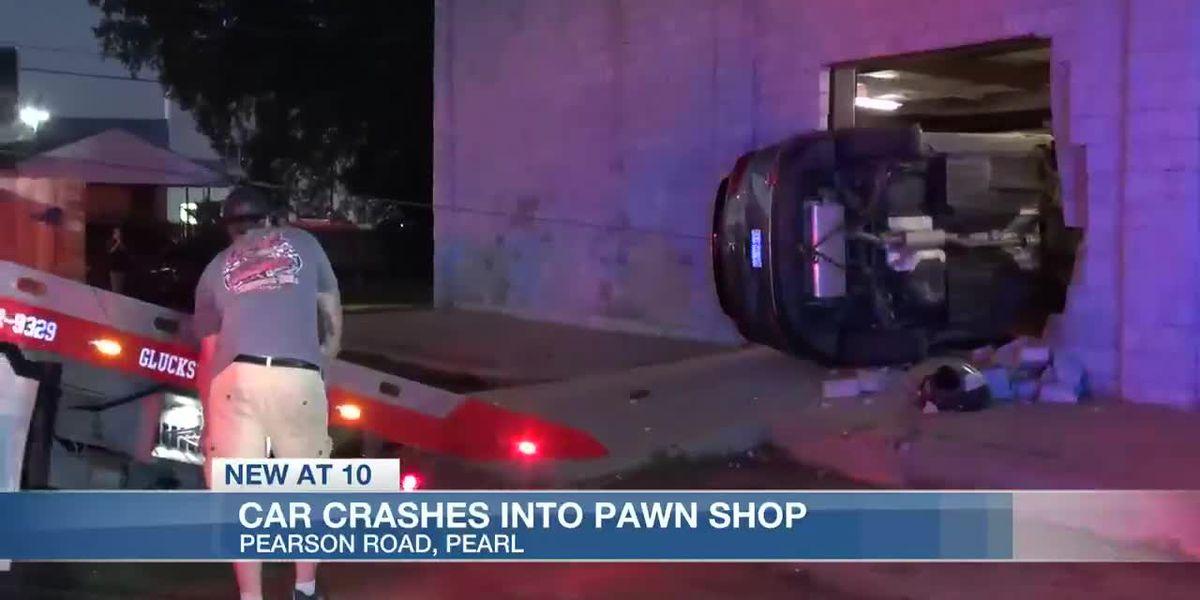Car crashes into wall of Pearl Pawn Shop, driver okay