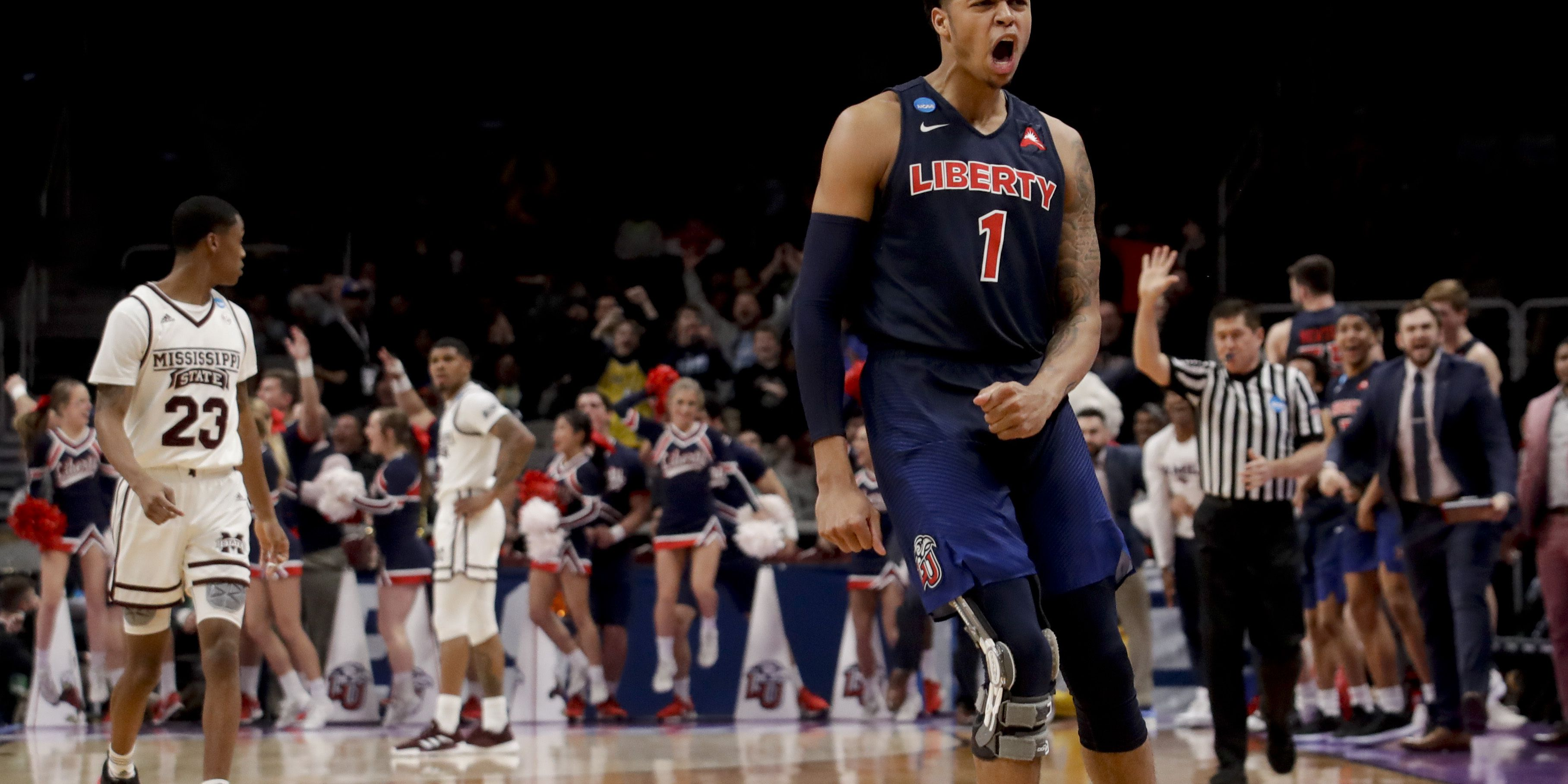 Liberty upsets Mississippi St. 80-76 for 1st tourney win