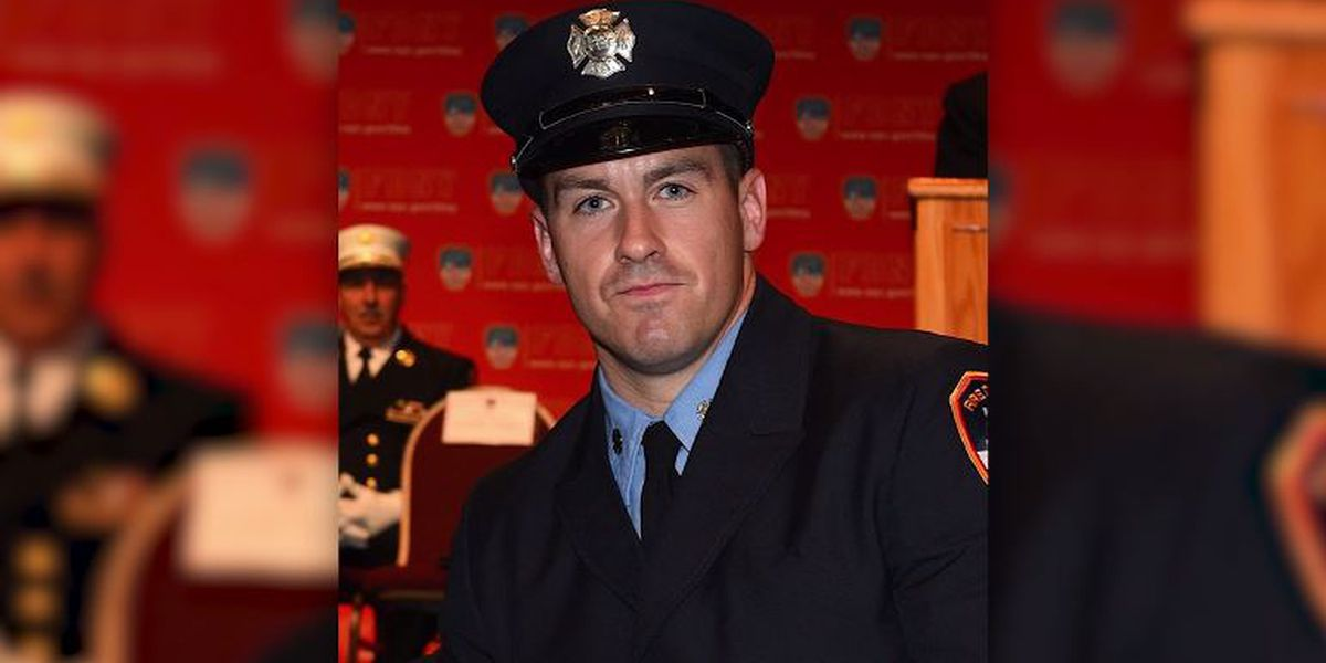Firefighter dies after falling through gap in road while responding to car accident