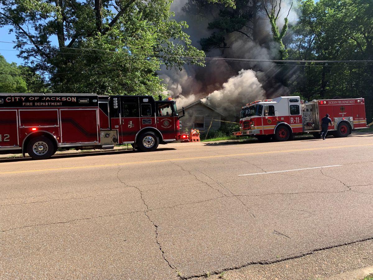 Firefighters battling blaze at home on Cooper Road