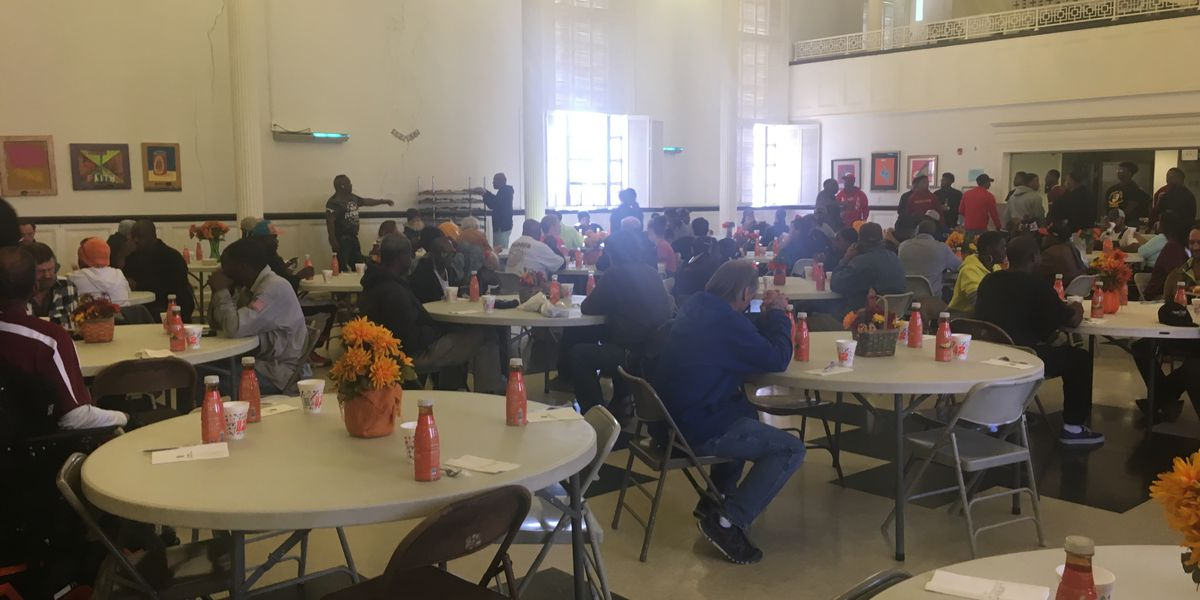 Stewpot volunteers serve Thanksgiving meals to the needy