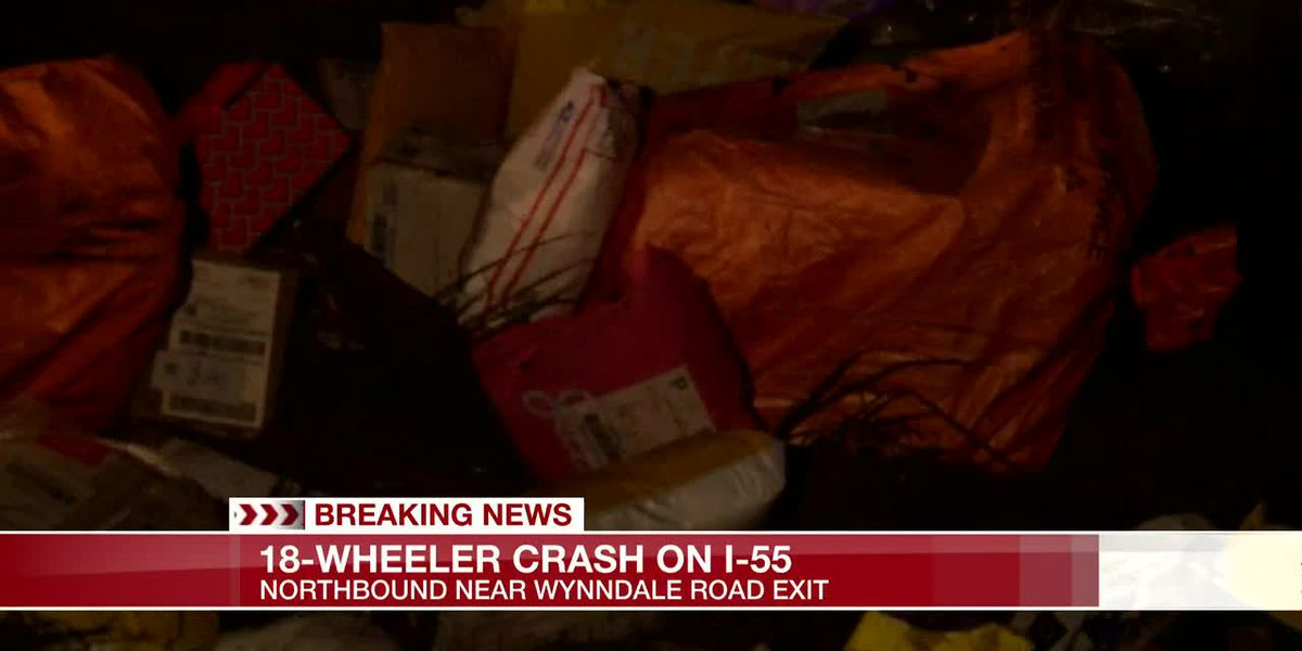 Semi-truck loaded with mail overturns on I-55